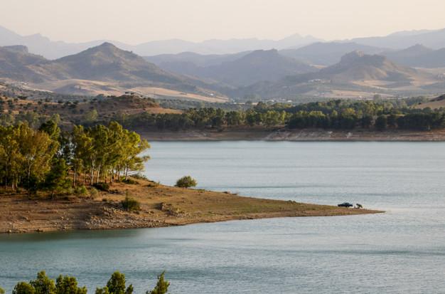 Conde De Guadalhorce Reservoir At Sunset.