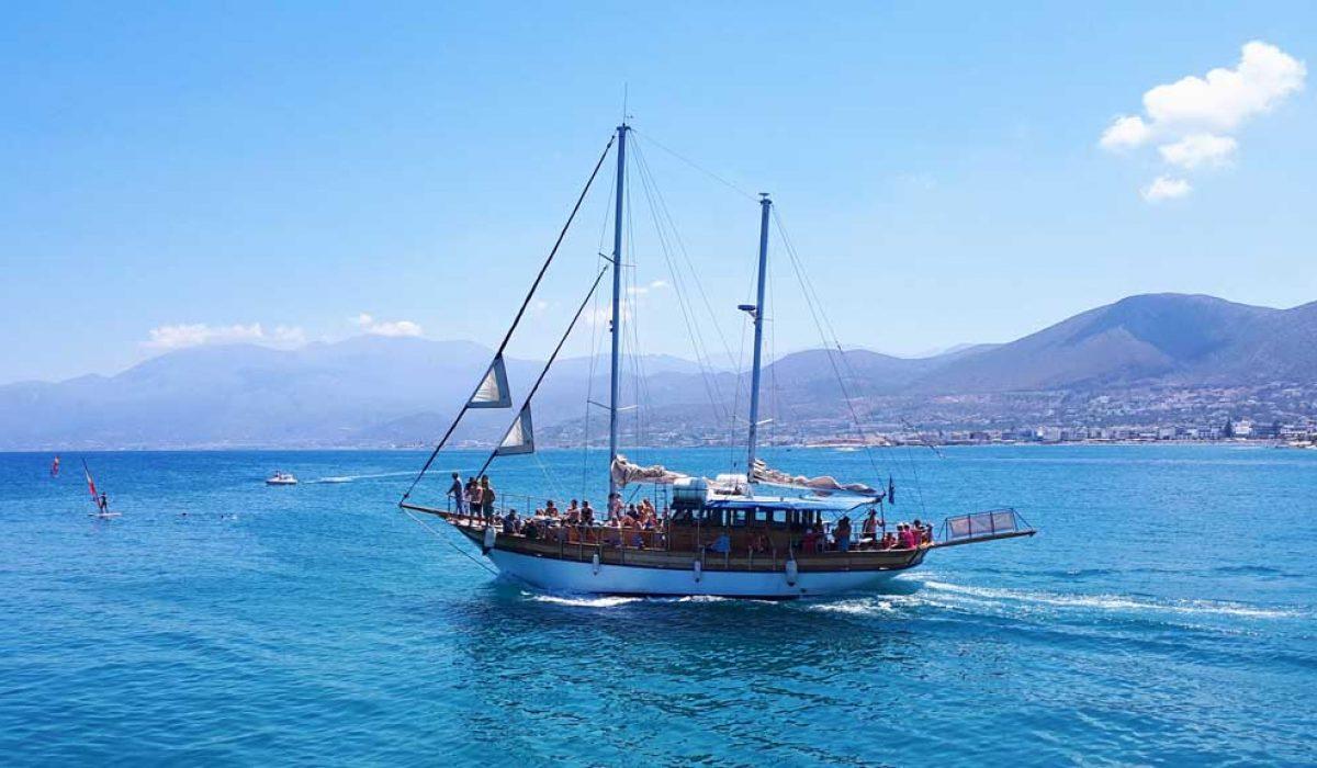 Boats at sea in malia, crete island, greece